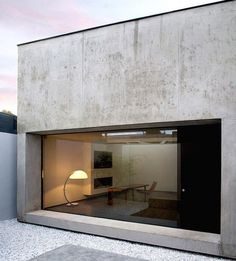 JKC architecture, concrete facade with large glass opening