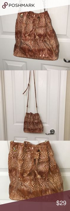 "Deux Lux Drawstring Crossbody Handbag New Crossbody Drawstring Bag.  Handle Strap is adjustable with Gold Chain Links  9x6 bottom  10"" tall.   Brown Print Never been used.   Deux Lux Drawstring Crossbody Bag Deux Lux Bags"