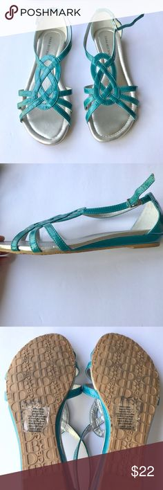 {dana buchman} silver and blue colored sandals Strappy turquoise blue sandals with silver colored insole. Worn once - comes with original box. Adjustable at the ankle strap. Pretty shoes for summer! Dana Buchman Shoes Sandals