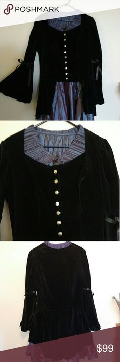 Classic Shrine Hollywood Black Velvet Frock Coat Witchy button-front frock coat with ruffled flounce peplum, bell sleeves with ribbon trim, and silver Roman coin design buttons. This piece is from early in the history of Los Angeles-based Romantic Gothic designer Shrine Hollywood and is no longer produced. Soft, thick velvet with deep pile.  PURPLE DRESS USED FOR STYLING ONLY. IT IS NOT PART OF THIS LISTING AND IT IS NOT FOR SALE. Shrine Hollywood Jackets & Coats