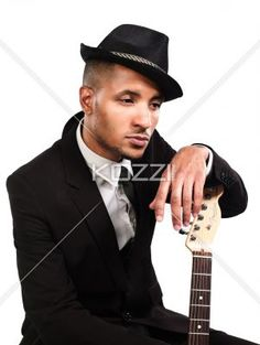 businessman thinking with guitar. - Businessman thinking with guitar over white background, Model: Kareem Duhaney