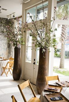 Love the tall vases and spring flowers...