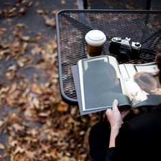 Autumn leaves, camera and coffee