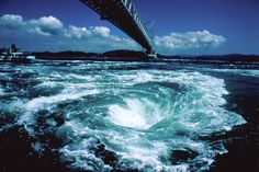 30 reasons to go to Japan before you die - tsunagu Japan: Naruto Whirling Waves / Tokushima. Naruto Whirling Waves is counted as one of the Top 3 Tides on Earth. Above it, you can see the 1629 km-long beautiful bridge, Ōnaruto Bridge. The Beautiful Country, Beautiful Places, Importance Of Water, Tokushima, Go To Japan, Natural Phenomena, Illustrations And Posters, Viria, Japan Travel