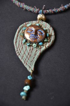 Face and fabric Pendant (Etsy)