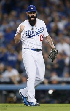 Los Angeles Dodgers pitcher Brian Wilson pumps his fist at the end of the top of the 8th inning against the Atlanta Braves in Game 4 of the National League division baseball series Monday, Oct. 7, 2013, in Los Angeles. (AP Photo/Danny Moloshok)