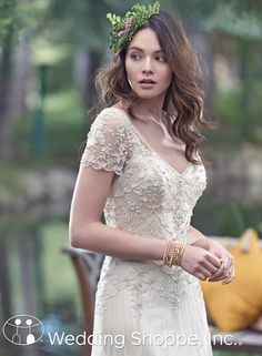 Maggie Sottero Amal: A gorgeous 1920s inspired beaded wedding dress with short sleeves.