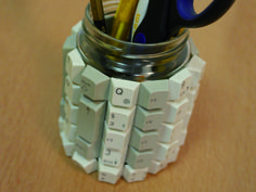 This pencil jar is made from an old glass jar and keyboard keys.
