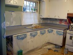 If you remember in a previous post  we took my kitchen looking like this:  to this: After I had my cabinets painted and looking MUCH better....