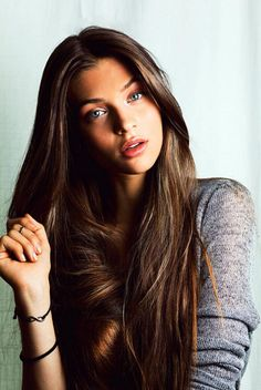{ long Brown hair }