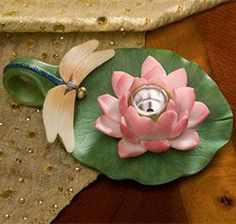 Dragonfly & Water Lily Candle Holder @ Harriet Carter - Great price for 2 - Great Idea for a Centerpiece for your Princess and the Frog Theme Event.  At Harriet Carter who knew?  - Read the Reviews.  Too Cute.