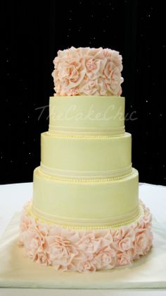 - Ivory and Blush Flower Ruffle Wedding Cake.  From bottom: Vanilla cake/Strawberry cream filling, Chocolate cake/Caramel pecan filling, Strawberry cake/Vanilla bean filling, and Carrot cakes/Cream cheese filling.  All iced in buttercream with fondant flower ruffle detail.