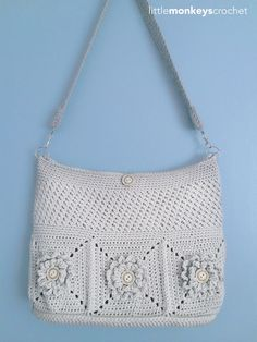 The Wildflower Shoulder Crochet Bag is a gorgeous crochet pattern. This incredibly versatile purse is a neutral creme color, so it pairs well with any type of outfit. You can dress it up for work or dress it down with jeans and a t-shirt. The crochet flower detail really makes this easy bag pattern stand out. The buttons in the center of the flowers add a special touch to this bag. You won't be able to make just one purse when you discover all the ways you can use this wardrobe st...
