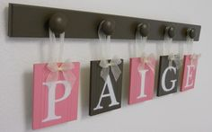 Kids Alphabet Letters Wooden. Set Includes 5 Hooks and Babies Name PAIGE - Pink and Brown. Baby Girls Room Wall Decor. $25.00, via Etsy.