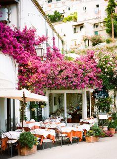 outdoor dining & pink bougainvillea in positano, italy