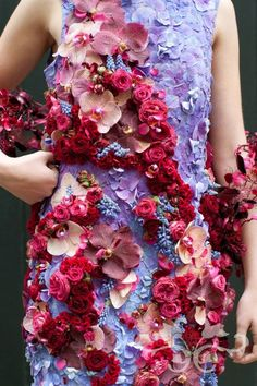 Dresses designed and created with fresh flowers. Neill Strain Floral Couture, London.