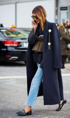 a navy maxi coat with loafers