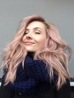 Candy-colored pastel pink hair is a perfect match for long, loose mermaid waves. (Image courtesy Aveda Institute student Morgan. Formula in comments.