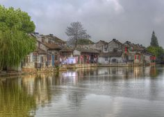 Xitang Houses,  by Maoli, via Flickr  Xitang is an ancient scenic town in Jiashan County, Zhejiang Province, China. Photo by Jerry Thomas