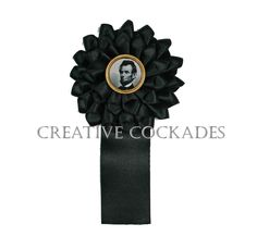Silk Lincoln Mourning Cockade with Vintage Pin. $65.00, via Etsy.