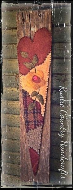 Heart mounted on weathered pallet wood hung with rusty wire