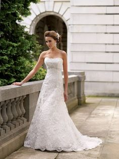 This is a simple lace wedding gown with an embellished bust line seam. It's completely understated yet classy and delicate. Click the image above to learn more about this East Tennessee bridal boutique, Southern Belle Bridal. Photo credit: Southern Belle Bridal
