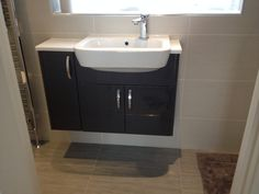 Finished Job Calypso Furniture with Metalwood Platino wall tiles and Metalwood Piombo floor tiles
