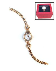 Be both punctual and fashionable. This feminine wrist watch features a brilliant band of pretty chain link piecing, inlaid gemstone hearts, and studded butterfly accents. Perfect for pairing with either your favorite casual outfits or for keeping track of time at the office. Comes boxed for effortless gift giving or for convenient storage.