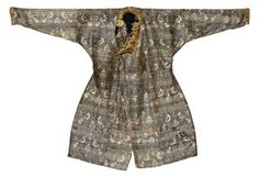 CENTRAL ASIA, 11TH/12TH CENTURY  Slightly waisted, with fur collar and cuffs, the decoration with repeated confronted hawks over a lattice formed by thin stems and composite palmettes, very good condition overall 47 x 69in. (120 x 175cm.)