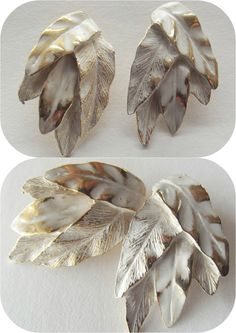 """Vintage 50s Marcelle Originals Goldtone Deco Feather Leaf Earrings Clip On    This is a beautiful pair of vintage 1950's Clip on Earrings made by """"Marcelle Originals"""" and they are stamped with the signature.  They are made of  gold tone metal with a white wash over coat in an art deco, feathery leaf design. They have clip backs and  are in a great larger size.    They measure 1 1/2"""" long and 3/4"""" wide.    These are truly ONE OF A KIND!   They are in Excellent condition- 9 1/2 out of 10…"""