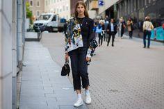 Veronika Heilbrunner, in Prada jacket, Vetements jeans, and Eytys sneakers
