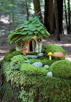 Fairy house on moss covered tree stump. The cottage roof is made of green leaves. Such a pretty miniature moss garden cottage. All the green is so woodland and calming. Fairy Garden Houses, Garden Cottage, Gnome Garden, Fairy Garden Images, Fairies Garden, Fairy Furniture, Furniture Online, Furniture Design, Furniture Chairs