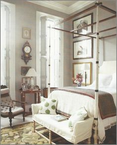 bedroom with taupe walls and white trim,  green accents and a mix of different wood colors