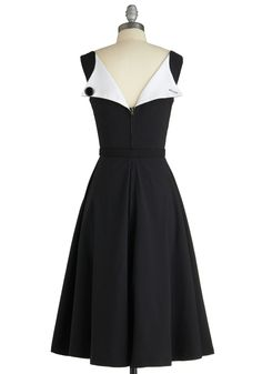 The Evening Unfolds Dress in Black. Wondering how to best impress your party date, you decide to keep it classic in this 1950s-inspired frock byBettie Page Clothing! #black #modcloth