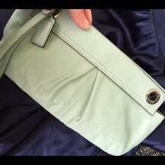 Coach mint clutch! Coach Mint green clutch! All leather 100% authentic! 12 inches by 7 inches! Great condition only used one time! Coach Bags Clutches & Wristlets