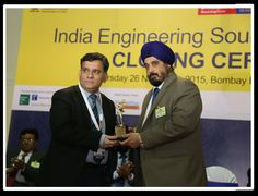 Mr. T. S. Bhasin, Chairman, EEPC INDIA, presenting the trophy for Best Pavilion in the Small Enterprise category to Nirmal Industrial Controls Pvt. Ltd.
