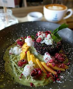 2016 The Golden Dragon ; Black sticky rice, fresh Mango & raspberries,  coconut sago, matcha pandan pond, freeze dried berries.  The black sticky rice was cooked well and slight warm on a pool of delicious matcha pandan and coconut sauce for you to mop up all the sauce to eat with the sticky rice. The coconut sago #haventailoringcoffeejoyously  #cappuccino #coffeeart #currant #blackstickyrice l