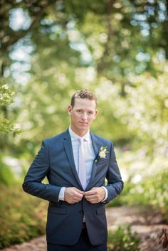 Handsome groom with pink tie at summer barn wedding in Maryland