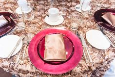Mocha rosette table linen with raspberry charger plates for a pop of color
