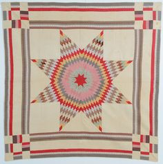 Lone Star Quilt: Circa 1880; Pennsylvania. This Lone Star (aka Star of Bethlehem or Texas Star) quilt is enhanced by the multiple borders and unusual Nine Patch corner blocks. Stella Rubin Antiques.