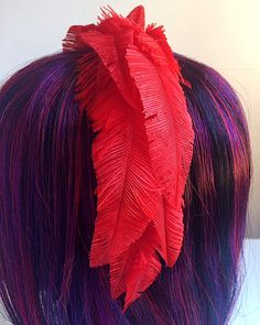 Red ostrich feather fascinator