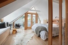 """attic bedroom  much too """"modern"""" for me, but I so dig the patio"""