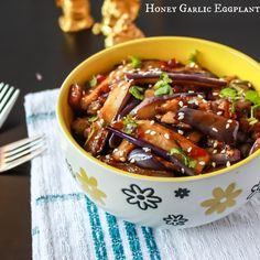 Honey Garlic Eggplant - Fried Chinese eggplant coated in honey garlic sauce, topped with sesame seeds and served with rice. Fragrant and delicious!