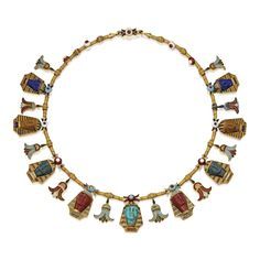 Gold, Hardstone Cameo and Enamel Necklace Supporting cameos in the form of Pharaoh heads composed of lapis lazuli, brown jasper, green jasper, red jasper and turquoise, spaced by lotus flower motifs, applied throughout with enamel in red, white, blue, green and turquoise hues, decorated with granulation and twisted gold wire accents, last quarter 19th century.