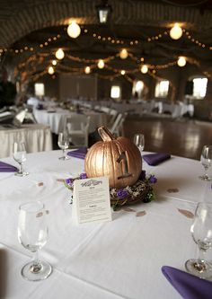 fall wedding centerpiece with small pumpkin table number