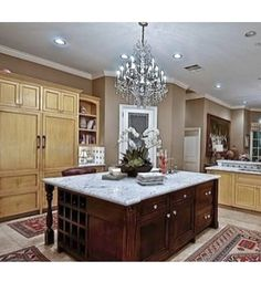 Love that chandelier in the kitchen! wow wee!! :) O and love kitchen too!