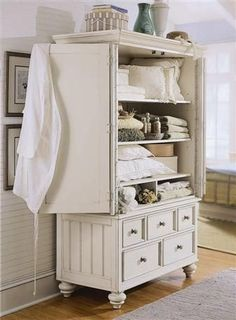 pictures of old tv armoires turned into bars | Great old armoire turned into a linen closet. Also a good idea to ...