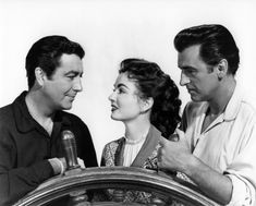 Ann Blyth is flanked by Robert Taylor and Stewart Granger in All the Brothers Were Valiant (1953)