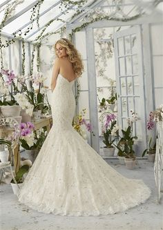 2016 Wedding Dress ♥ Stunning Beaded Lace on Tulle Over Satin Mermaid Gown with a Scalloped Sweetheart Strapless Neckline, Beaded Lace Fitted Bodice Past Hips, Lightly Padded Bust Cups & Boning, Beaded Lace Flared Mermaid Skirt with Scalloped Lace Hemline, Chapel Train, Scalloped Lace V-Back with Covered Buttons. #straplessweddingdress #dreambridalgown #2016weddingdress #mermaid #crystalweddingdress #laceweddingdress #sayyestothedress