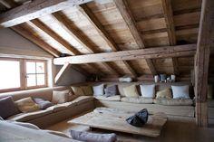 Great loft idea / rough exposed beams / built in sofa